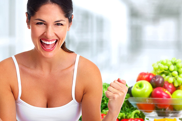 Happy healthy young fitness woman. Weight loss and dieting.